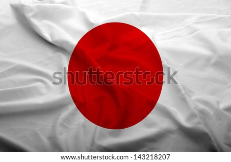 Waving flag of Japan. Flag has real fabric texture.