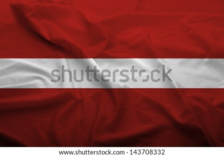 Waving flag of Latvia. Flag has real fabric texture.