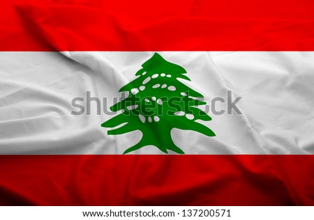 Waving flag of Lebanon. Flag has real fabric texture.