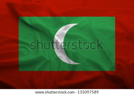 Waving flag of Maldives. Flag has real fabric texture.