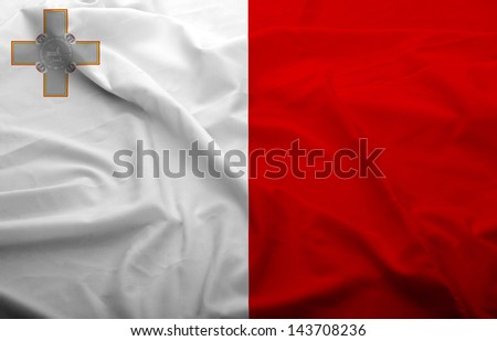 Waving flag of Malta. Flag has real fabric texture.