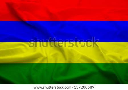 Waving flag of Mauritius. Flag has real fabric texture.