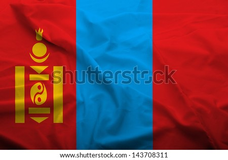 Waving flag of Mongolia. Flag has real fabric texture.