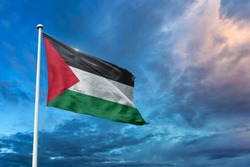 Waving Flag of Palestine with beautiful sky and clouds