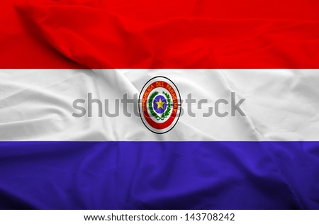 Waving flag of Paraguay. Flag has real fabric texture.