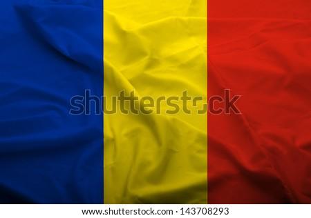 Waving flag of Romania. Flag has real fabric texture.