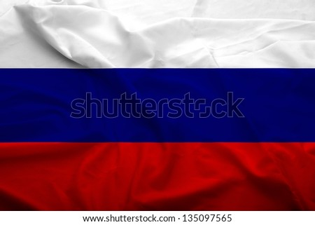 Waving flag of Russian Federation. Flag has real fabric texture.