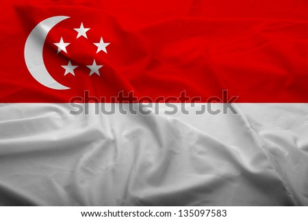 Waving flag of Singapore. Flag has real fabric texture.