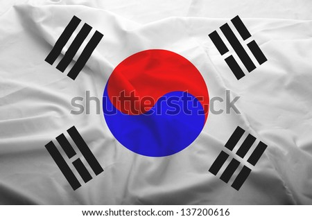 Waving flag of South Korea. Flag has real fabric texture.