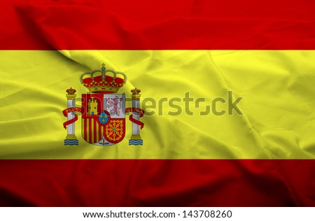 Waving flag of Spain. Flag has real fabric texture.