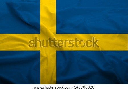 Waving flag of Sweden. Flag has real fabric texture.