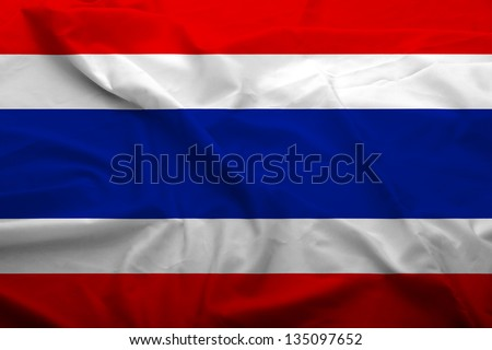 Waving flag of Thailand. Flag has real fabric texture.