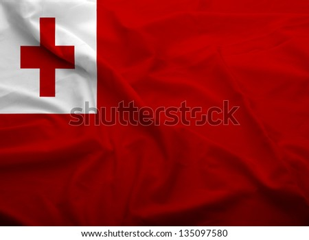 Waving flag of Tonga. Flag has real fabric texture.