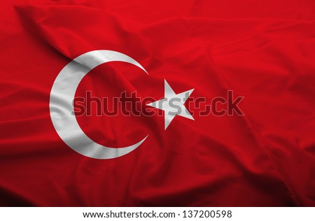Waving flag of Turkey. Flag has real fabric texture.