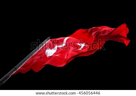 Waving flag of Turkey isolated on black background. Bottom view #456056446