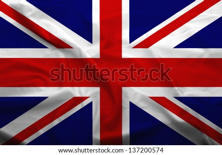 Waving flag of United Kingdom. Flag has real fabric texture.
