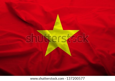 Waving flag of Vietnam. Flag has real fabric texture.