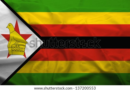 Waving flag of Zimbabwe. Flag has real fabric texture.