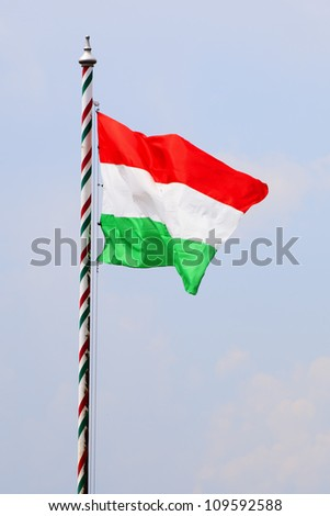 Waving Hungarian Flag Against Blue Sky