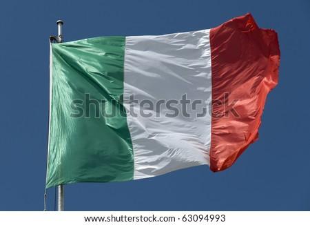 Waving Italian flag on natural sky