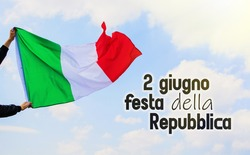 Waving Italy flag against blue sky, happy Republic Day in italian. national holiday of Italy, postcard with patriotic symbols