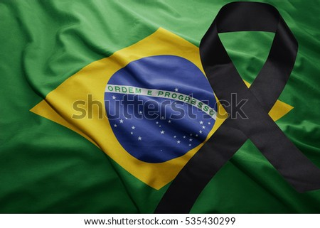 waving national flag of brazil with black mourning ribbon #535430299