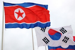 Waving North and South Korea Flags
