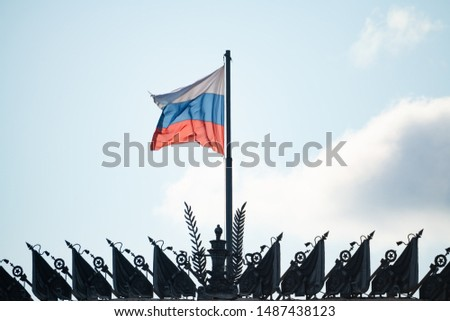 Waving the national flag of the Russian Federation in Moscow Russia against the bright blue sky exterior detail close-up view details