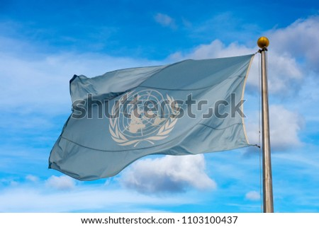 Waving united nations UN flag in the deep blue sky background #1103100437