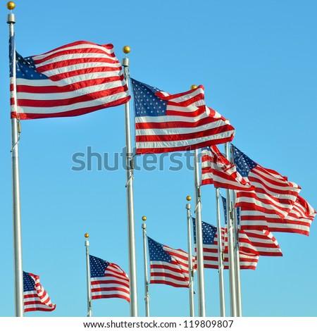 Waving United States flags on flagpoles - Washington DC United States