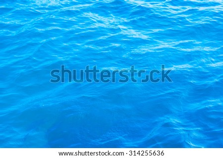 Waving water surface of the sea background #314255636