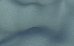Wavy grayish abstract background with concrete texture. Desktop wallpaper.