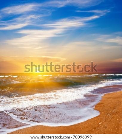 wavy  sea coast at the sunset