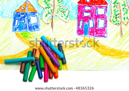 Wax crayons and made their children\'s drawing on a white background, isolated.