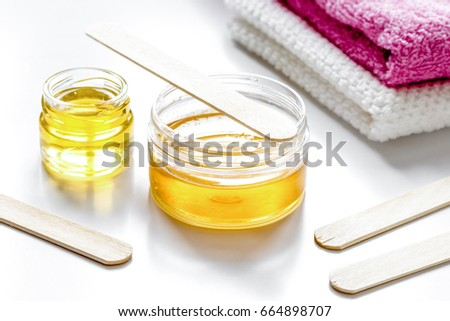 wax for depilation on white background