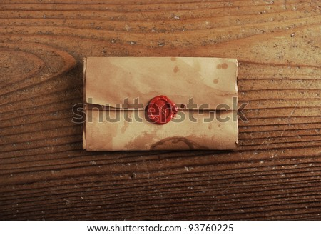 wax seal on a letter paper , background is wooden table