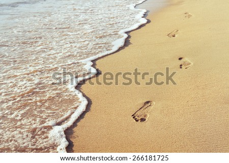 way to new life, wellbeing concept, Footprints in the sand