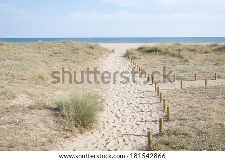 way to the empty sand  beach on Spanish coast