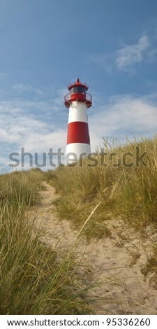 Way to the Lighthouse in the dunes at the German North Sea island Sylt - stock photo
