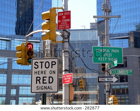 Way too many signs at an intersection in New York City