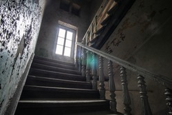 Way up to the window in the staircase in an old abandoned 19th century house
