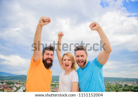 Ways to build ohesive team. Woman and men look confident successful sky background. Threesome stand happy confidently with raised fists. Behaviors of cohesive team. Celebrate success. Yes we can.