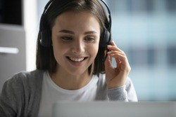 We are always glad to help you! Friendly capable young female in headphone set employee worker of hotline call center client support service talking to microphone assisting answering customer question
