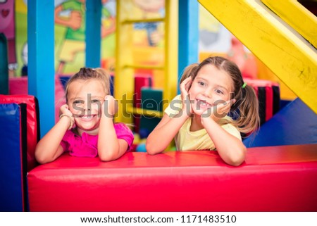 We are happy kids. Two little smiling girl in playground looking at camera. Space for copy. #1171483510