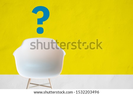 We are hiring chair in a waiting room of a hiring office in front of a yellow wall, with copy space for text and question mark. Hire employment employ interview concept