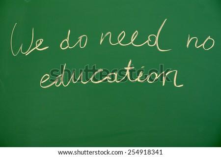 Stock Photo We do need no edukation handwritten on school blackboard