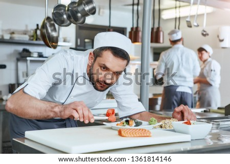 We know how to cook. Chef cook preparing japanese food in modern commerical kitchen #1361814146