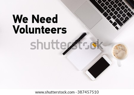 We Need Volunteers text on the desk with copy space #387457510