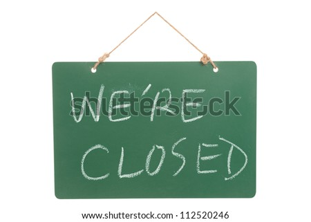 We're closed words on green board hanging and isolated on white