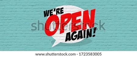 We're open again on speech bubble Foto d'archivio ©